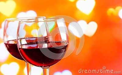 Two red wine glasses on hearts